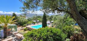 A view of the pool at Hotel Cala di l'Oru or nearby