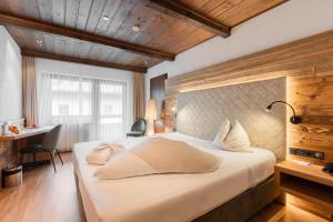 Ein Bett oder Betten in einem Zimmer der Unterkunft Alpenlove - Adult SPA Hotel