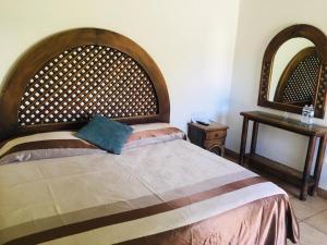 Cama o camas de una habitación en Hotel Posada El Encanto