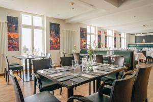 A restaurant or other place to eat at Astenturm Hotel & Restaurant