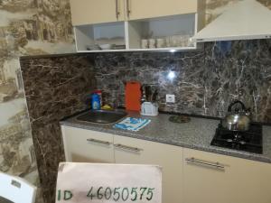 A kitchen or kitchenette at Квартиры в центре Сочи у Елены