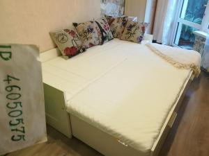 A bed or beds in a room at Квартиры в центре Сочи у Елены
