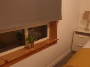 A television and/or entertainment center at Self-Contained Vacation Apartment Ann-St Greenock