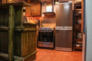 A kitchen or kitchenette at Le Rendezvous Apartment