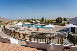 A view of the pool at Hospes Palacio de Arenales & Spa or nearby
