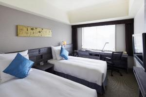A bed or beds in a room at ANA Crowne Plaza Kanazawa, an IHG Hotel