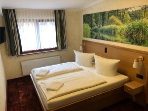 Ein Bett oder Betten in einem Zimmer der Unterkunft Gasthof zum Slawen