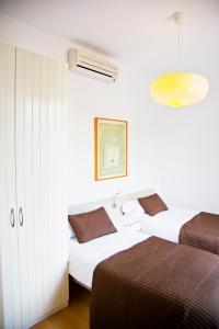 Cama o camas de una habitación en Claris Apartments