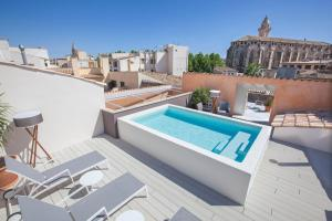 A view of the pool at Boutique Hotel Posada Terra Santa or nearby