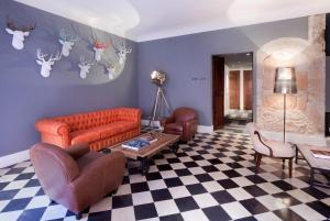 A seating area at Boutique Hotel Posada Terra Santa