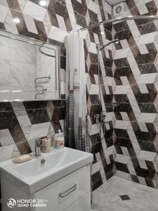 Ванная комната в Апартаменты жк Кавказ