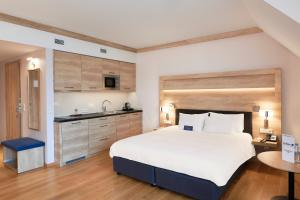 A bed or beds in a room at Radisson Blu Hotel & Residences