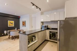 A kitchen or kitchenette at Artistic 2BR in Luxury Building