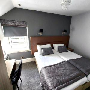 A bed or beds in a room at Newmachar Hotel