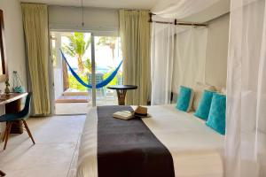 A bed or beds in a room at Cabanas Tulum- Beach Hotel & Spa
