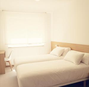A bed or beds in a room at Rua do Medio