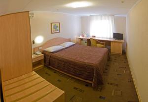 Кровать или кровати в номере Гостиница Премьер