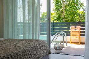 A bed or beds in a room at Aelia Seaside Luxury Suites