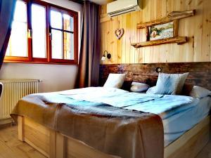 Posteľ alebo postele v izbe v ubytovaní Hotel Ribno Superior