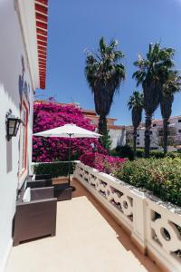 A balcony or terrace at Pergola Boutique Hotel