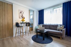 A seating area at W&K Apartments - Compact I