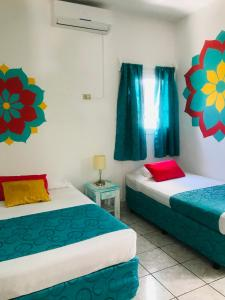 A bed or beds in a room at HC Liri Hotel