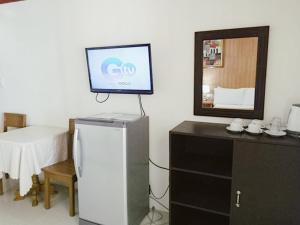 A television and/or entertainment centre at Shenna's Beach Resort