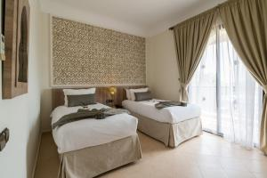 A bed or beds in a room at Marrakech Ryads Parc All inclusive