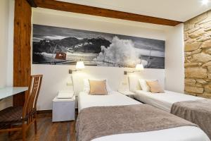 A bed or beds in a room at Pension Aida