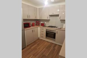 A kitchen or kitchenette at 3 Bedroom Modern Property
