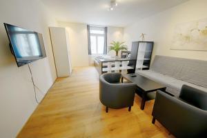 Ein Sitzbereich in der Unterkunft HITrental City Apartments