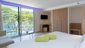 TV o dispositivi per l'intrattenimento presso Melbeach Hotel & Spa - Adults Only