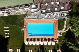A view of the pool at Tennerhof Gourmet & Spa de Charme Hotel or nearby