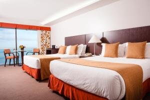 A bed or beds in a room at Rio Othon Palace