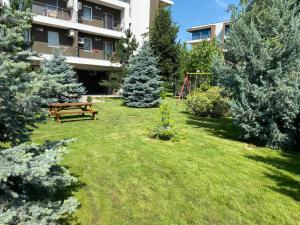 A garden outside Bucharest Airport Suites & Villas