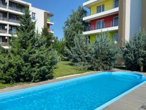 The swimming pool at or near Bucharest Airport Suites & Villas