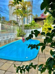 The swimming pool at or close to Pousada Flor de Ponta Negra