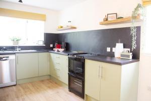 A kitchen or kitchenette at East Kilblean Cottage