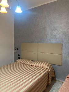 Letto o letti in una camera di Hotel Royal