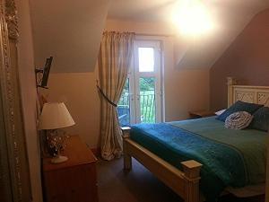 Letto o letti in una camera di Crockatinney guest house
