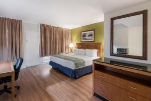 A bed or beds in a room at Americas Best Value Inn-Painted Post