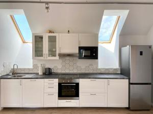 A kitchen or kitchenette at S5 Apartment