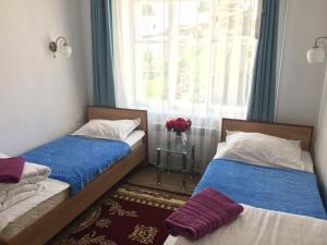 A bed or beds in a room at KbH-Karakol based Hostel