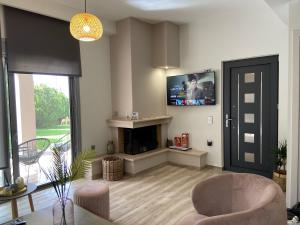 A television and/or entertainment center at Aggelikis House