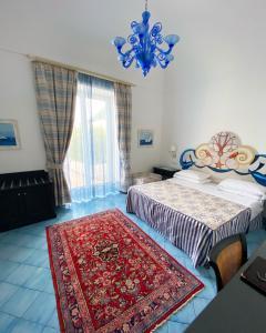 Letto o letti in una camera di Palazzo Marzoli charme Resort