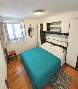 Łóżko lub łóżka w pokoju w obiekcie Villa Riva