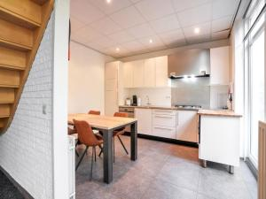A kitchen or kitchenette at Charming Holiday Home in Vijlen with Garden