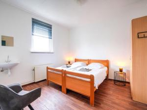 A bed or beds in a room at Charming Holiday Home in Vijlen with Garden