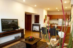 A television and/or entertainment center at Flores Hotel Boutique