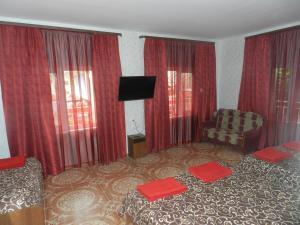 Кровать или кровати в номере Guest House Larisa